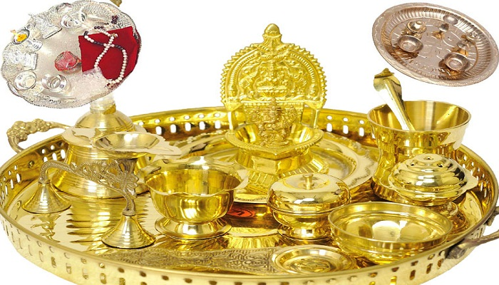 gold and silver utensils in pooja